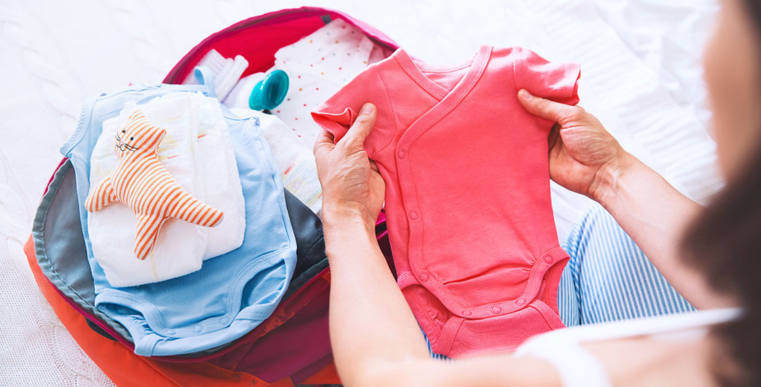packing baby clothes